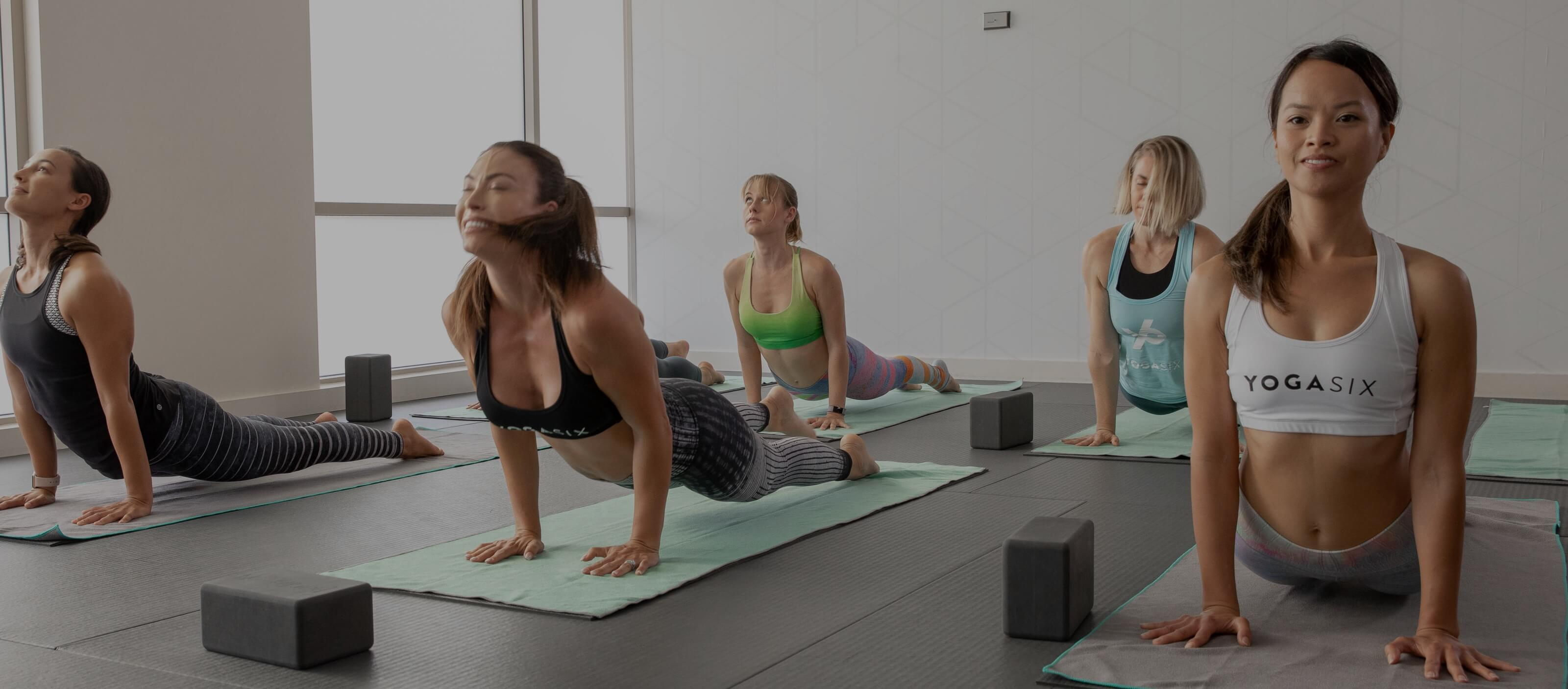 Fitnessrooms groups yoga session ends with a sweaty